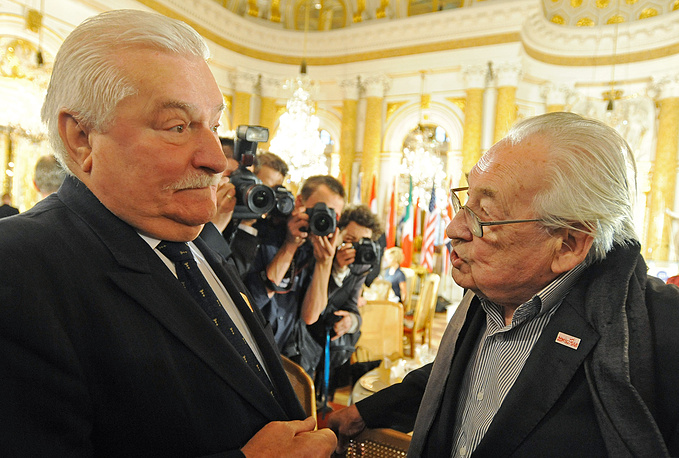 Former Polish President and leader of the Solidarity movement Lech Walesa, left, speaks with Oscar winning film director Andrzej Wajda at the Royal Castle in Warsaw, Poland, Tuesday, June 4, 2013, prior to a Freedom of Speech award ceremony. (AP Photo/Alik Keplicz)